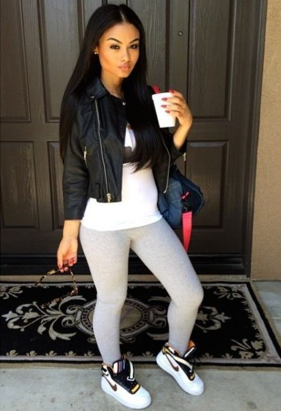 black leather jacket with white tunic t-shirt and leggings