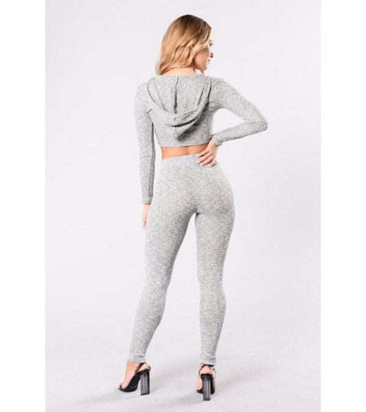 gray, short-cut hoodie with matching leggings and high-heeled heels