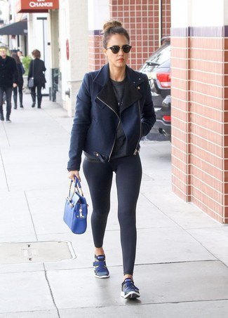 dark bomber blazer with dark blue leggings and sneakers