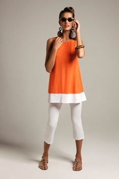 sleeveless top made of orange block tunic with white capri leggings