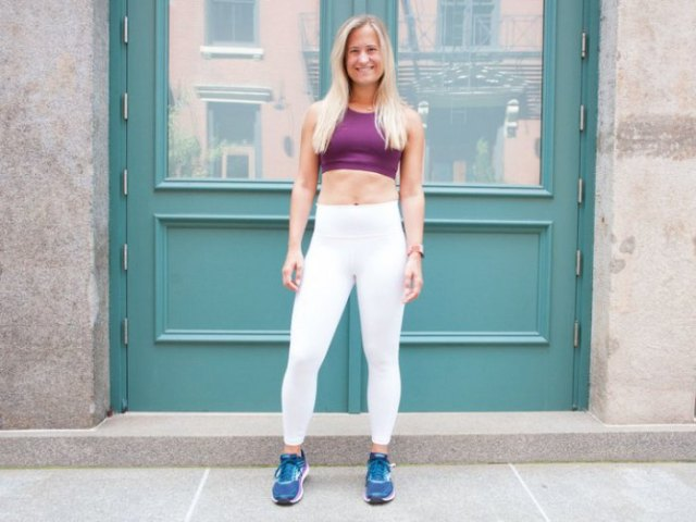 black crop top with white leggings and running shoes
