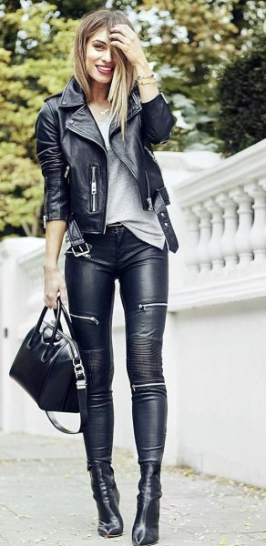 black slim fit moto jacket with gray t-shirt and leather leggings