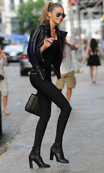 black leather jacket with leggings and ankle boots