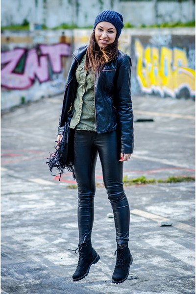 Leather jacket with a gray chambray shirt and dark blue knitted hat