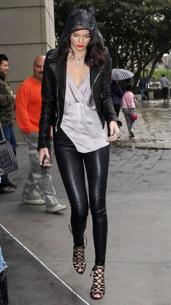 gray silk tunic blouse with V-neck and leather gaiters