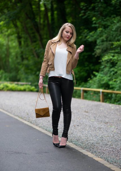 brown leather jacket with white t-shirt with a scoop neck and black leggings