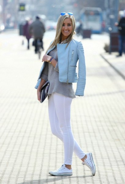 light blue leather jacket with white leggings and canvas shoes