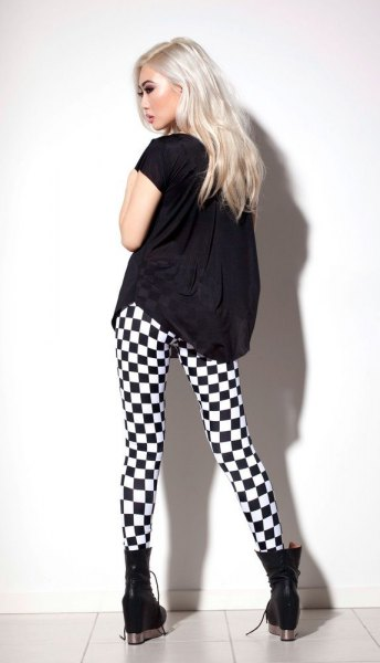 black t-shirt with checkered leggings and ankle boots