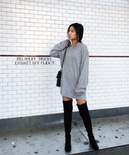 light gray sweatshirt dress with thigh-high flat boots