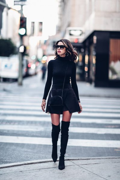 black, figure-hugging sweater with stand-up collar and minirate skirt