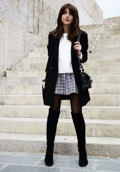 black long blazer with checkered mini skirt and over the knee boots