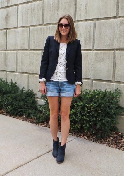 black blazer with mini denim shorts and dark blue boots