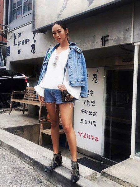 blue denim jacket with white blouse with bell sleeves and mini shorts
