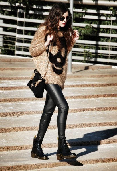 Blush pink and black printed sweaters with leather leggings