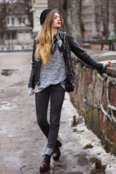 gray sweater with black leather jacket and cuff jeans