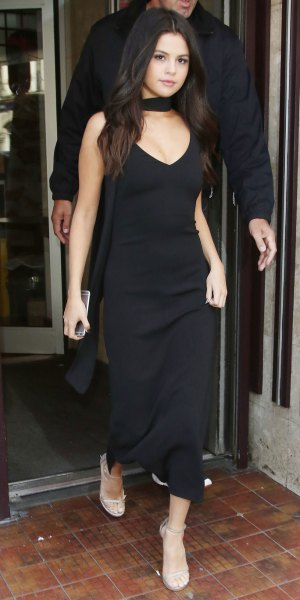 black maxi dress with deep V-neck and bare sandals
