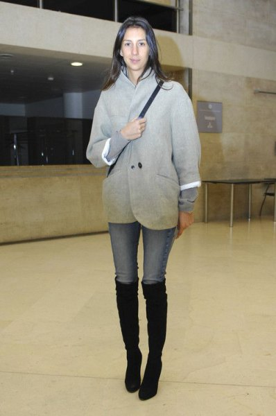 gray wool coat with light blue skinny jeans and black boots