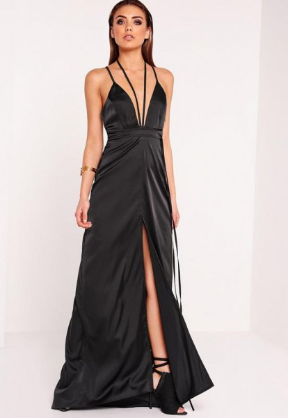 black, deep maxi dress with deep V-neck and flared high-split