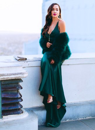 black maxi satin dress with deep V-neck and cape made of faux fur