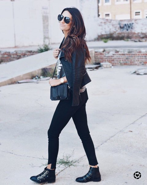 black leather jacket with gray t-shirt and skinny jeans