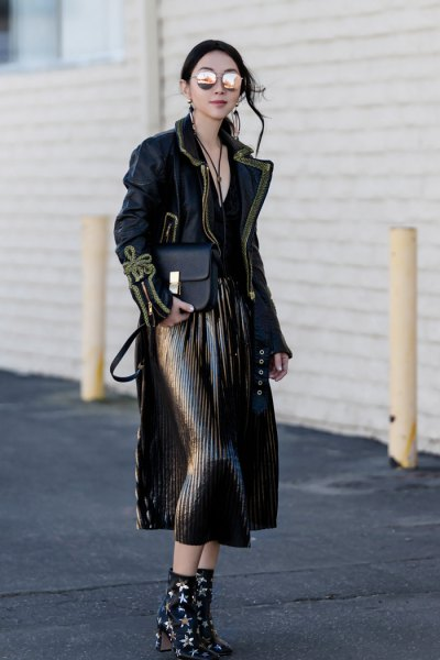 black maxi jacket with pleated midi skirt and star-studded ankle boots with heel