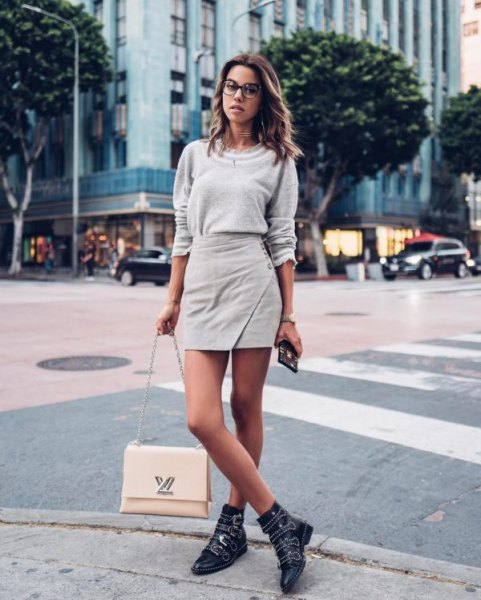 gray sweater with mini wrap skirt and studded boots