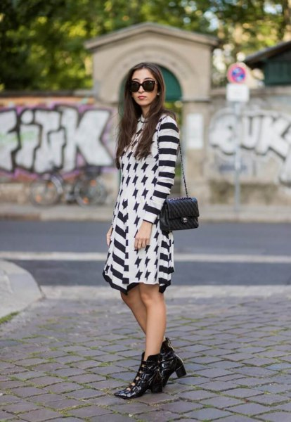 black and white striped mini dress with pointed leather toe boots