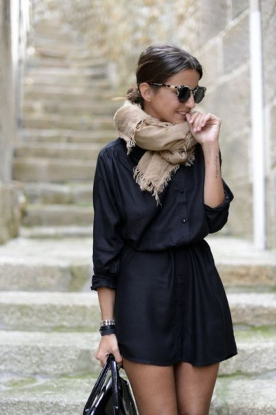 black shirt with buttons and high waisted mini skirt