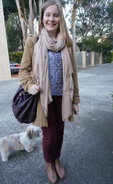 Light pink scarf with tribal printed sweater and blush coat