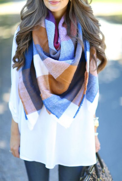 blue-orange-white scarf with white tunic blouse and leggings