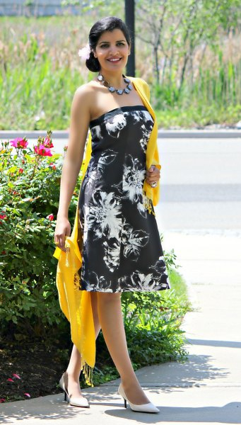 black and white tube dress with floral pattern and yellow scarf