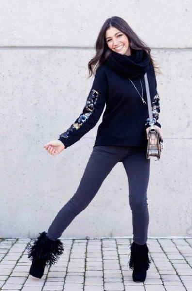 black sweatshirt with infinity scarf and dark gray skinny jeans