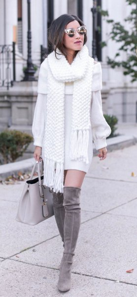 white fringed scarf with matching sweater dress and gray over the knee boots