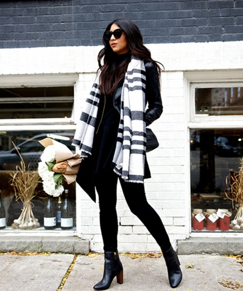 Black and white scarf with mock-neck sweater and leather jacket