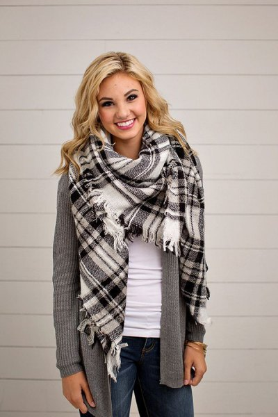 black and white checkered blanket scarf with gray, torn cardigan