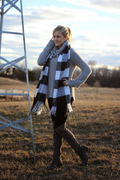 gray sweater with a waterfall neckline and checkered fringed scarf