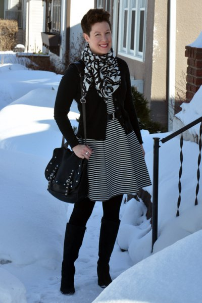 black and gray striped tunic dress with belt and knee high boots