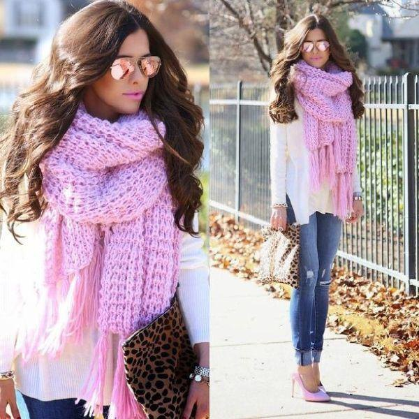white blouse with light pink knitted scarf with fringes and blue jeans with cuff