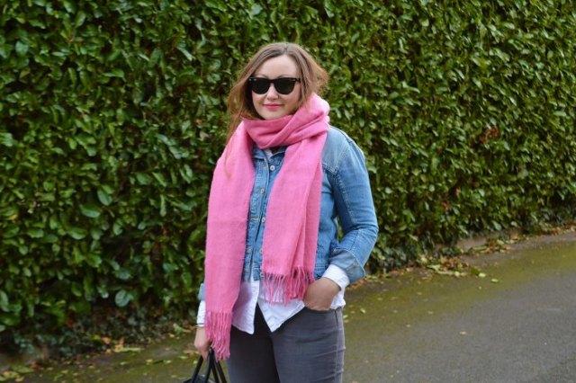 blue denim jacket with white shirt and shocking pink scarf
