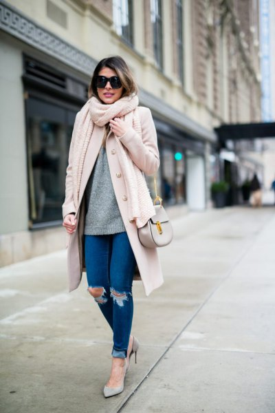 white longline wool coat with blue skinny jeans with cuffs
