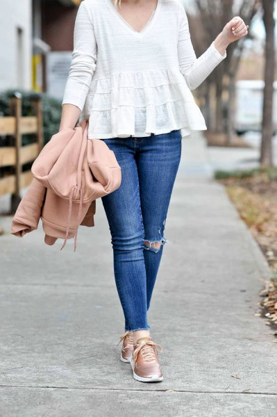 white v-neck peplum blouse and black skinny jeans