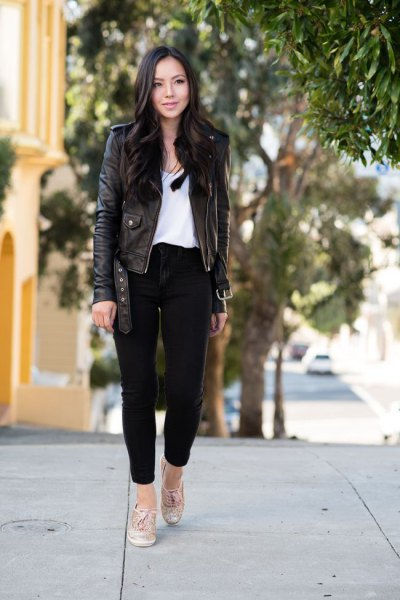 black leather jacket with ankle jeans and white blouse with a scoop neck