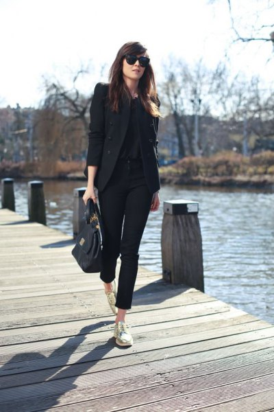 black blazer with shortened chinos and gold low-top sneakers