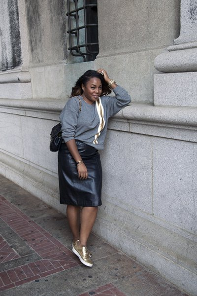 gray, chunky sweater with leather skirt and white-gold sneakers