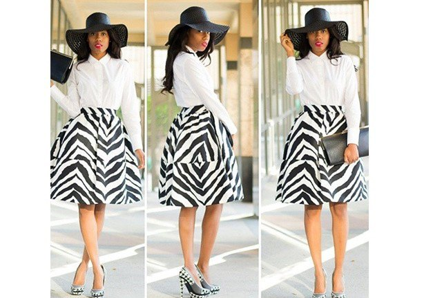 white shirt with buttons, flared midi skirt with zebra print and floppy church hat