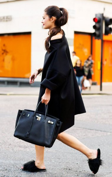 black midi shift dress with submarine neckline, slippers and black leather handbag