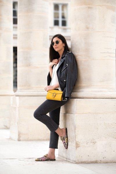 black leather jacket with dark blue skinny jeans