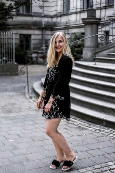 black printed long-sleeved mini dress with golden slippers