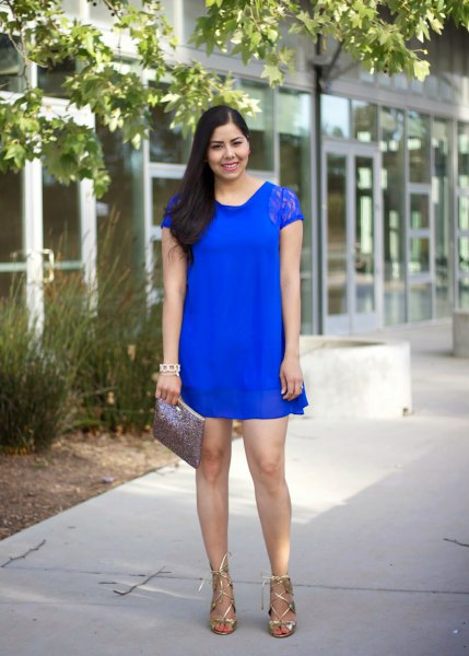 royal blue mini shift dress made of lace with cap sleeves and metallic strappy heels