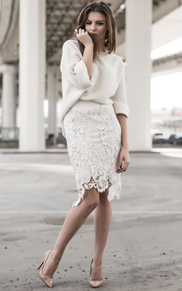 white, chunky sweater with knee-length lace skirt